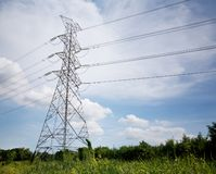High voltage transmission towers to itself stock photography