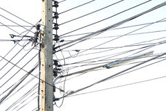 Electricity post and overgrown electricity line Stock Image