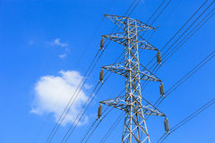 Electricity post. Electricity pylon against blue cloudy sky Royalty Free Stock Images