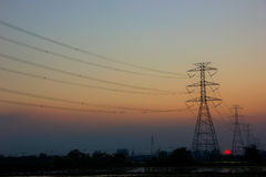 Electricity post sunset. At Karnchanaburi Thailand Royalty Free Stock Images