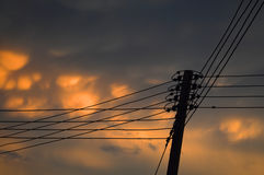Electricity post at sunset Royalty Free Stock Photo