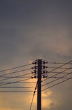 Electricity post at sunset Stock Photo