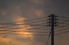 Electricity post at sunset Stock Photos