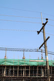 Electricity post and underconstruction building. The electricity post and underconstruction building Stock Photography