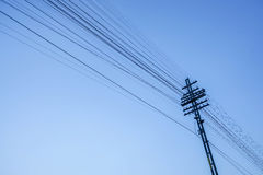 Electricity post with wire in blue sky Royalty Free Stock Image