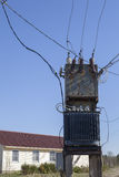 Electricity Power Distribution Transformer near the residential Royalty Free Stock Images