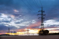 Electricity - Power energy Industry - Electric poles at the suns. Et with coloful sky stock photos