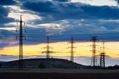 Electricity - Power energy Industry - Electric poles at the suns. Et with coloful sky royalty free stock photo