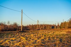 Electricity power line poles construction in middle of fields in countryside. Energy royalty free stock images