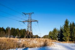 Electricity power line poles construction in middle of fields in countryside. Energy stock photography