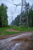 Electricity power line poles construction in middle of fields in countryside. Energy stock image