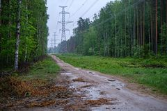 Electricity power line poles construction in middle of fields in countryside. Energy stock photos