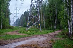 Electricity power line poles construction in middle of fields in countryside. Energy royalty free stock photo