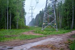 Electricity power line poles construction in middle of fields in countryside. Energy royalty free stock photography