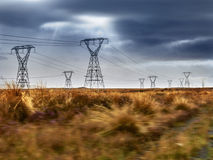Electricity Power Lines. Electricity pylons against a stormy sky in Tongariro National Park New Zealand stock images