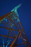 Electricity power plant from below. Night shot of a power plant, perspective from below, green lighted, Baku, Azerbaijan royalty free stock photography