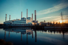 Electricity power plant near a river Royalty Free Stock Photography