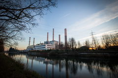 Electricity power plant near a river Royalty Free Stock Photo