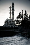 Electricity power plant near a river Royalty Free Stock Images
