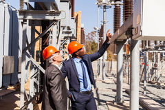 Electricity power plant. Professional managers inspecting electricity power plant Royalty Free Stock Photography