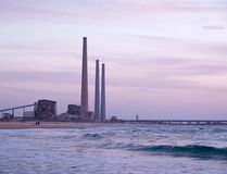 Electricity power plant by the sea Royalty Free Stock Images