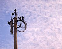 Electricity power pole with many disconnected wires on blue clou royalty free stock image