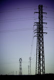 Electricity Power Pylons silhouettes Royalty Free Stock Photography
