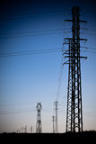 Electricity Power Pylons silhouettes Royalty Free Stock Image