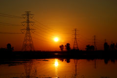 Electricity pylon. And Sunset, Thailand Royalty Free Stock Photo