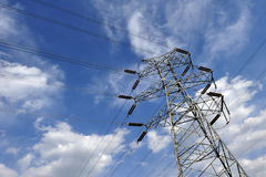 Electricity pylon. Power tower standing in the blue sky and white clouds Royalty Free Stock Photos