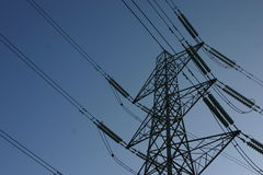 Electricity pylon. Photograph of an electricity pylon against a blue sky stock photo