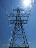 Electricity Pylon. With sun behind Stock Photos