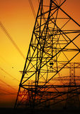 Electricity Pylon. Over orange sunset sky. Environmental damage royalty free stock photo