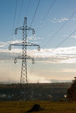 Electricity pylon. High voltage pylon against blue sky Stock Photography