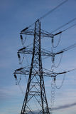 Electricity pylon. Photograph of an electricity pylon against a blue sky stock photography