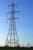 Electricity Pylon. Photo of an electricity pylon against a darkening blue sky Royalty Free Stock Images