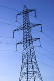 Electricity Pylon. Photo of an electricity pylon against a blue sky Stock Images