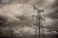Electricity pylon. With many cables on cloudy  moody sky Stock Photography