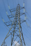 Electricity Pylon. An electricity pylon with a clear blue sky in the background Stock Photography