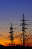 Electricity Pylon. Over orange sunset sky Stock Images