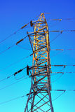 Electricity pylon. HDR the image electricity pylon against an intense blue sky Royalty Free Stock Photos