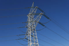 Electricity pylon. Before blue sky Royalty Free Stock Images