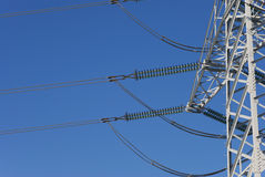 Electricity pylon. Before blue sky Royalty Free Stock Photo