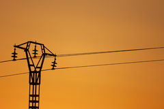 Electricity Pylon. At a sunrise Stock Photos