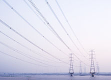 Electricity pylon. S on the river Stock Images