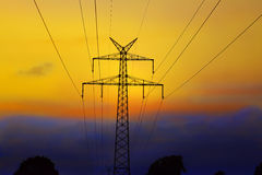 Electricity pylon. On sunrise with streamlines Royalty Free Stock Images