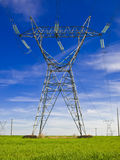 Electricity pylon. A electricity tower on a green field Royalty Free Stock Photos