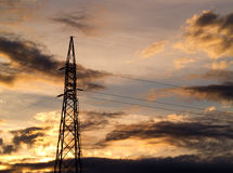 Electricity pylon. Silhouetted against beautiful cloudy sky stock photos
