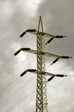 Electricity Pylon. A electricity pylon with a cloudy sky Stock Photo