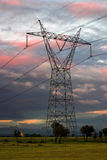 Electricity pylon. Against sunset cloudy sky Royalty Free Stock Photo